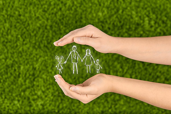 Image of hands protecting a family illustrates one of the main benefits of life insurance.