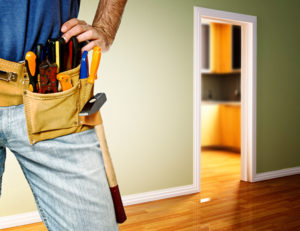 A homeowner with a tool belt ready for preventative home maintenance